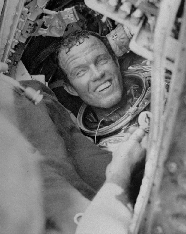 photo - Astronaut Gordon Cooper is all smiles as he prepares to leave his Faith 7 Mercury space capsule after his record-breaking flight. (NASA photo)