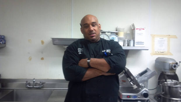 photo - Former Edmond running back and Michigan star Che Foster, who is now a sous chef for Crystal Garden Catering in Howell, Mich. Photo provided