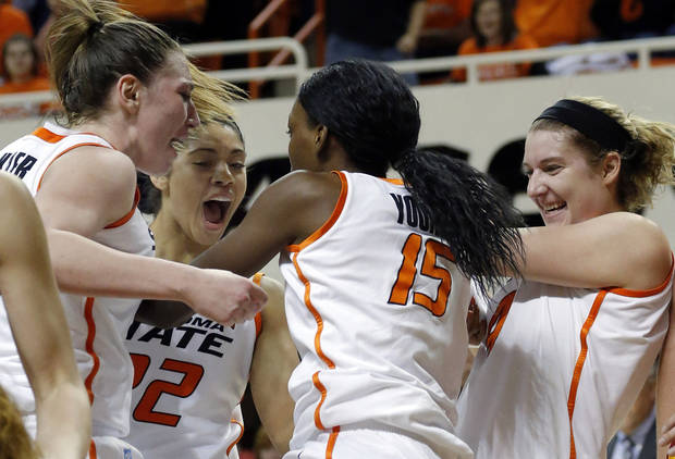 photo - Oklahoma State&#039;s Lindsey Keller (25), Brittney Martin (22), Liz Donohoe (4) celebrate with Toni Young (15) during the women&#039;s college basketball game between Oklahoma State and Iowa State at  Gallagher-Iba Arena in Stillwater, Okla.,  Sunday,Jan. 20, 2013.  OSU won 71-42. Photo by Sarah Phipps, The Oklahoman