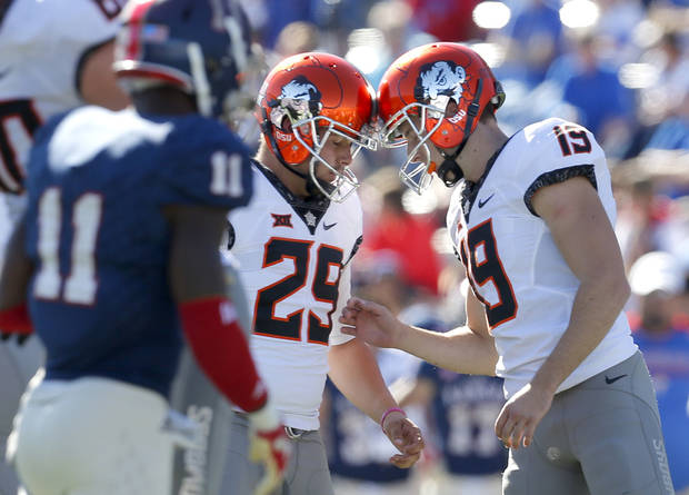 Oklahoma State's Zach Sinor (29) abd Oklahoma State's Ben Grogan (19) celebrate in the third quarter during the college football game between the Oklahoma State Cowboys (OSU) and the Kansas Jayhawks at Memorial Stadium in Lawrence, Kan., Saturday, Oct. 22, 2016.   Photo by Sarah Phipps, The Oklahoman