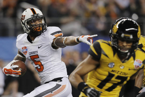photo - Oklahoma State wide receiver Josh Stewart (5) gestures on his way in for a touchdown against Oklahoma State during the first half of the Cotton Bowl NCAA college football game on Friday, Jan. 3, 2014, in Arlington, Texas. (AP Photo/Brandon Wade)