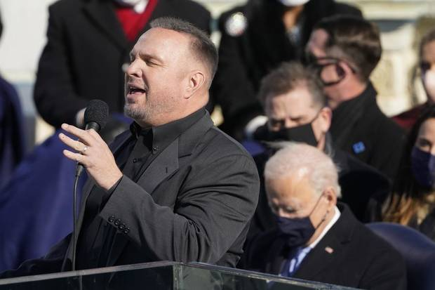 "Garth Brooks sings ""Amazing Grace"" as President Joe Biden listens during the 59th Presidential Inauguration at the U.S. Capitol in Washington, Wednesday, Jan. 20, 2021. [AP Photo/Andrew Harnik]"