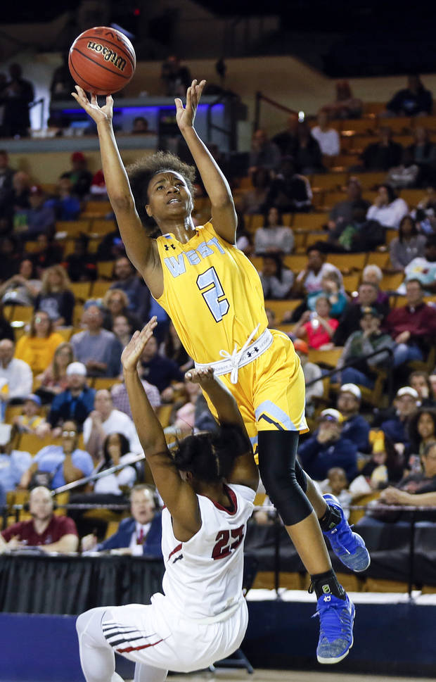 Putnam City West's Ce'Nara Skanes (2) shoots over Owasso's Tiya Douglas (25) during a Class 6A girls state championship high school basketball game between Putnam City West and Owasso at ORU's Mabee Center in Tulsa, Okla., Saturday, March 10, 2018. Owasso won 53-51. Photo by Nate Billings, The Oklahoman