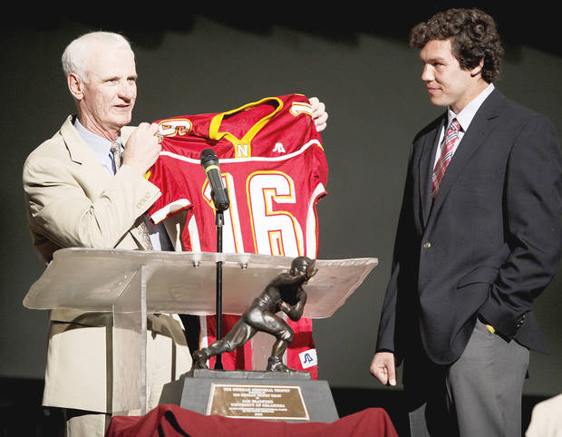 photo - Putnam City North football coach Bob Wilson, left, holds up Sam Bradford's high school jersey during a ceremony to retire Bradford's jersey Friday. Photo by Bryan Terry, The Oklahoman