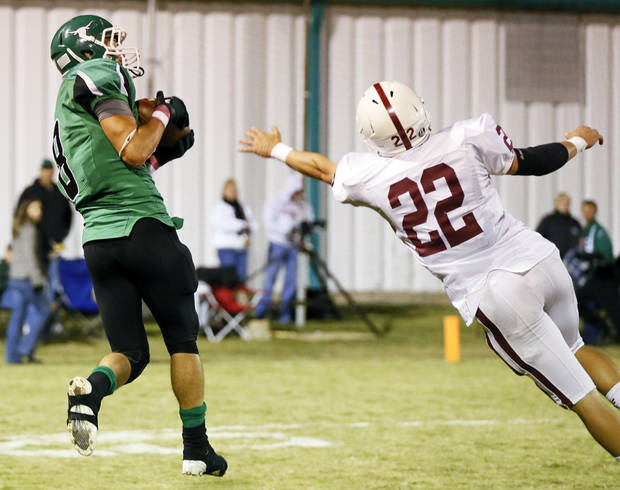 photo - Levi Fox (8) of Jones makes a touchdown catch past Tuttle's Deakon Mincey (22) during a high school football game between Jones and Tuttle in Jones, Okla., Friday, Oct. 25, 2013. Photo by Nate Billings, The Oklahoman