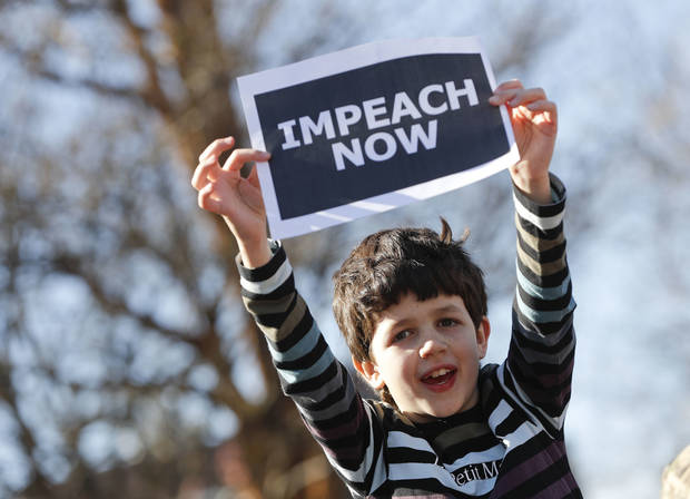"Marcel Ast, 10, from New Jersey, holds up a sign during a ""Not My Presidents Day"" rally at DuPont Circle in Washington, Monday, Feb. 20, 2017. Anti-President Donald Trump activists seized on Monday's federal holiday to organize rallies in cities around the country to oppose policies by Trump. (AP Photo/Pablo Martinez Monsivais)"