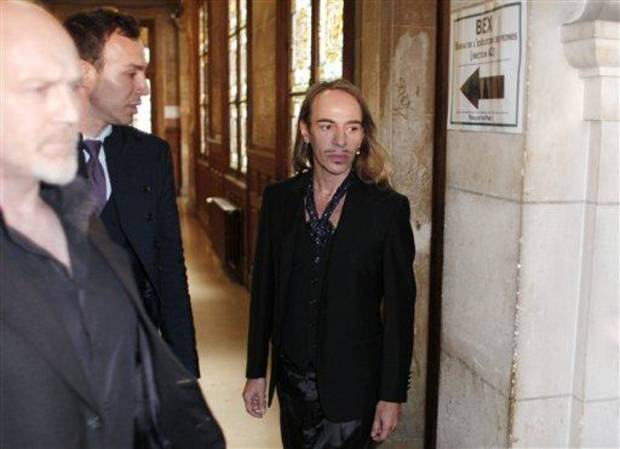 photo - FILE -In this June 22, 2011 file photo, former Dior designer John Galliano arrives at the Paris court house, charged with hurling anti-Semitic slurs in a Paris cafe. Galliano has been invited to return to fashion in the studio of Oscar de la Renta. De la Renta invited Galliano to spend time in his office over the next three weeks, according to a statement released Friday by de la Renta's company. Galliano was dismissed as creative director of Christian Dior and left his own label two years ago after an anti-Semitic rant at a Paris cafe was captured on video. A French court also convicted him on two other complaints of anti-Semitic behavior.  (AP Photo/Thibault Camus, File)