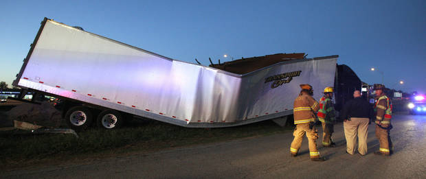 photo - A tractor-trailer in the 4000 block of SE 9 in Del City went through a building under construction after driving off Interstate 40 Thursday. The driver of the tractor-trailer died. Photo by Paul B. Southerland, The Oklahoman  <strong>PAUL B. SOUTHERLAND - PAUL B. SOUTHERLAND</strong>
