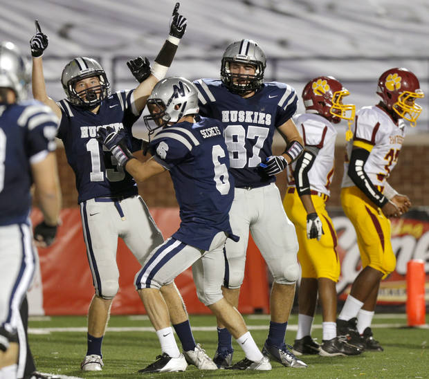 photo - Edmond North's Luke Rossi, left, Robert Secrets, and Jackson Silver celebrate after a touchdown against Putnam City North during a high school football game at Wantland Stadium in Edmond, Okla., Friday, September 21, 2012. Photo by Bryan Terry, The Oklahoman