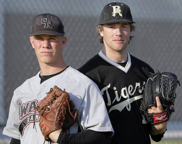 photo - HIGH SCHOOL BASEBALL: Owasso&#039;s Dylan Bundy and Broken Arrow&#039;s Archie Bradley, two of the area&#039;s hot pitching prospects, together at the Union field in Broken Arrow April 12, 2011, before their game next Friday. MICHAEL WYKE/Tulsa World ORG XMIT: DTI1104121927231930