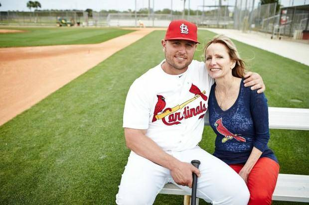 photo - Cardinals' Matt Holliday sits with his mother Kathy during the 2013 spring training in Jupiter. They participated in the photo shoot for the Siteman Cancer Center, where Kathy Holliday was treated for colon cancer. Photo by Jay Fram courtesy of Siteman Cancer Center. Photo by St. Louis Post-Dispatch
