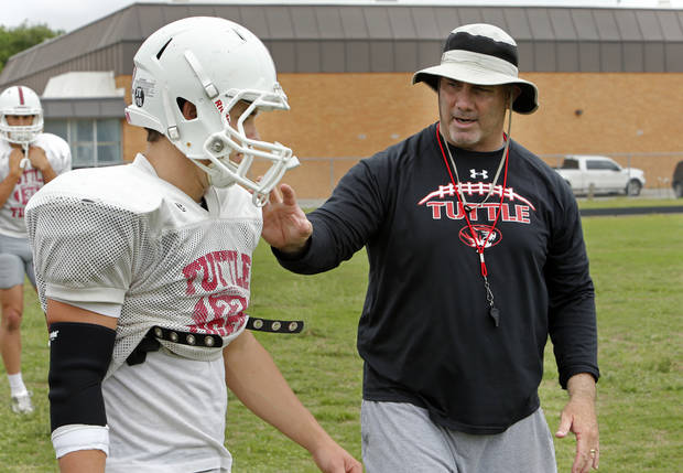 photo - Head football coach Phil Koons works with player Deakon Mincey (22) on Thursday, May 16, 2013, in Tuttle, Okla.  Photo by Steve Sisney, The Oklahoman