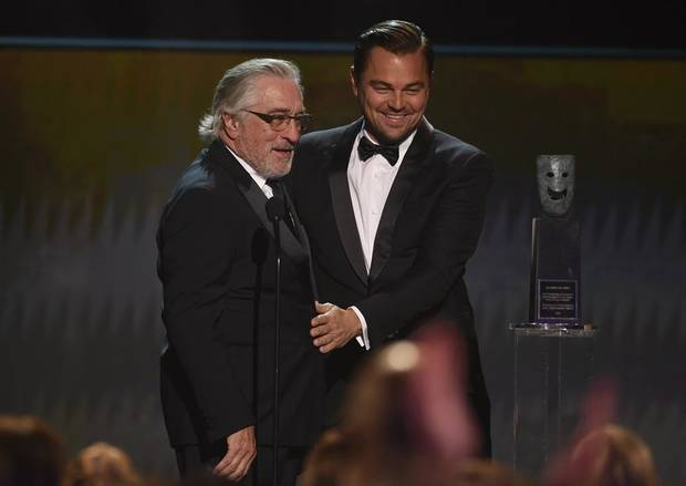 Leonardo DiCaprio, right, presents the lifetime achievement award to Robert De Niro at the 26th annual Screen Actors Guild Awards at the Shrine Auditorium & Expo Hall on Sunday, Jan. 19, 2020, in Los Angeles. [AP Photo/Chris Pizzello]