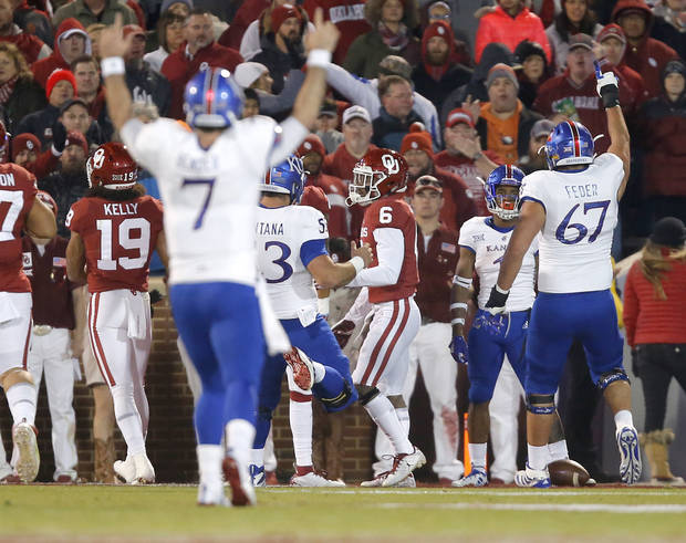 Kansas' Pooka Williams Jr. (1) celebrates a touchdown beside Oklahoma's Tre Brown (6) during a college football game between the University of Oklahoma Sooners (OU) and the Kansas Jayhawks (KU) at Gaylord Family-Oklahoma Memorial Stadium in Norman, Okla., Saturday, Nov. 17, 2018. Photo by Bryan Terry, The Oklahoman