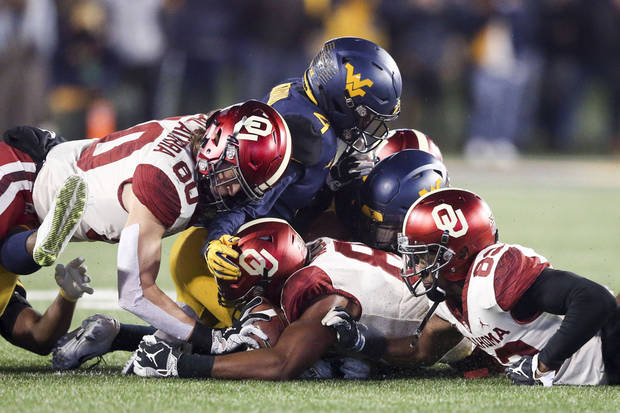 Players from OU and West Virginia battle for an onside kick in their game last November. (Photo by Ian Maule)