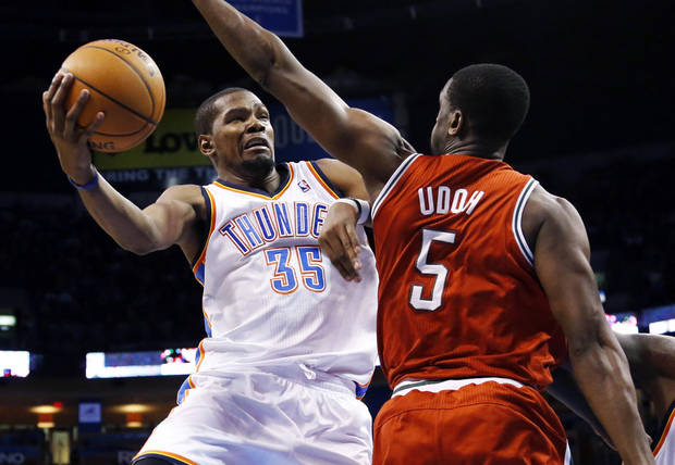 photo - Oklahoma City Thunder forward Kevin Durant (35) shoots defended by Milwaukee Bucks center Ekpe Udoh (5) in the third quarter of an NBA basketball game in Oklahoma City, Saturday, Jan. 11, 2014. Oklahoma City won 101-85. (AP Photo/Sue Ogrocki)