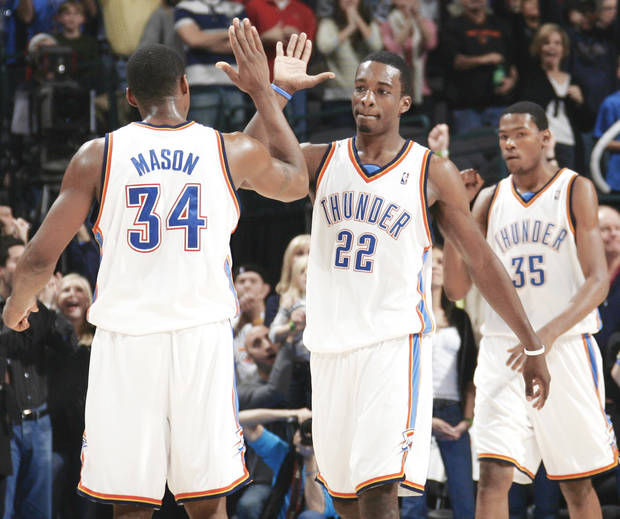 photo - The Thunder's Desmond Mason, Jeff Green and Kevin Durant celebrate late in the fourth quarter Friday. Photo by nate billings, the oklahoman