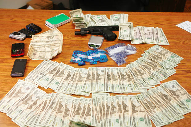 photo - A sampling of the more than $300,000 in cash confiscated by Grady County deputies and federal drug agents during a recent raid.  PHOTO PROVIDED BY GRADY COUNTY SHERIFF Art Kell