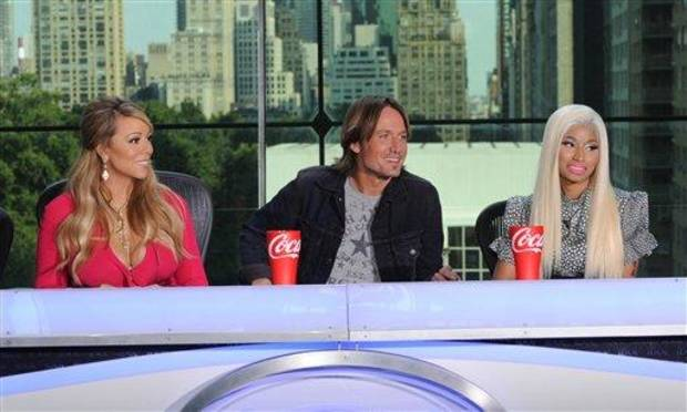 "photo - FILE - ThisSept. 17, 2012 file image released by Fox shows the new judges for the singing competition series, ""American Idol,"" from left, Mariah Carey, Keith Urban and Nicki Minaj and during a news conference in New York. Host Ryan Seacrest said Wednesday, Oct. 3, that things got intense between new judges Nicki Minaj and Mariah Carey during a tryout taping in Charlotte, N.C., the day before. In the midst of a dispute over a contestant, Minaj announced that she was no longer putting up with ""her ... highness,"" a reference to Carey with a few expletives added in. Another new judge, Keith Urban, was in the unenviable position of sitting between them. (AP Photo/FOX, Michael Becker)"