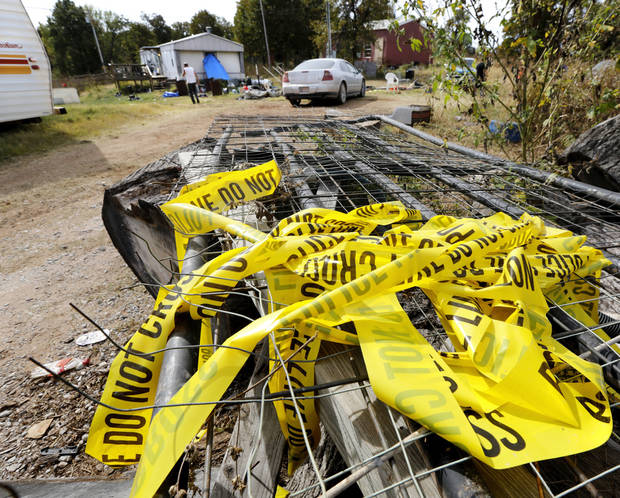 Crime tape is wadded up and left on a trailer on this property, 920819 S. 3310 Rd., in Lincoln County onTuesday, Oct. 25, 2016. Investigators released this crime scene this week following their investigation of a shooting rampage committed here by Michael Dale Vance who engaged in a shootout with Wellston police officers, injuring two of them.  He then stole one of the officer's vehicle and continued his crime spree, carjacking a vehicle from a Wellston couple, and then driving to the home of relatives in nearby town of Luther where he is believed to have killed the man and woman who lived there. Photo by Jim Beckel, The Oklahoman