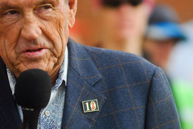 Former Oklahoma State basketball coach Eddie Sutton wears a pin to commemorate the ten members of the Oklahoma State basketball family killed in a 2001 plane crash. Sutton spoke to runners before the beginning of the Seventh Remember the Ten Run on the campus of Oklahoma State on April 20, 2013. [The Oklahoman Archives]