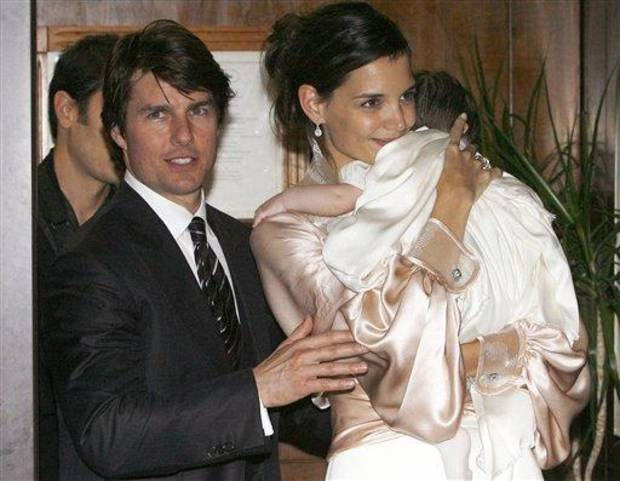 photo - FILE - In this Nov. 17, 2006 file photo, U.S. actor Tom Cruise, and U.S. actress Katie Holmes with their daughter Suri, who became engaged in June 2005, leave a restaurant in Rome. Cruise and Homes are calling it quits after five years of marriage. Holmes' attorney Jonathan Wolfe said Friday June 29, 2012 that the couple is divorcing, but called it a private matter for the family. (AP Photo/Alessandra Tarantino, File)