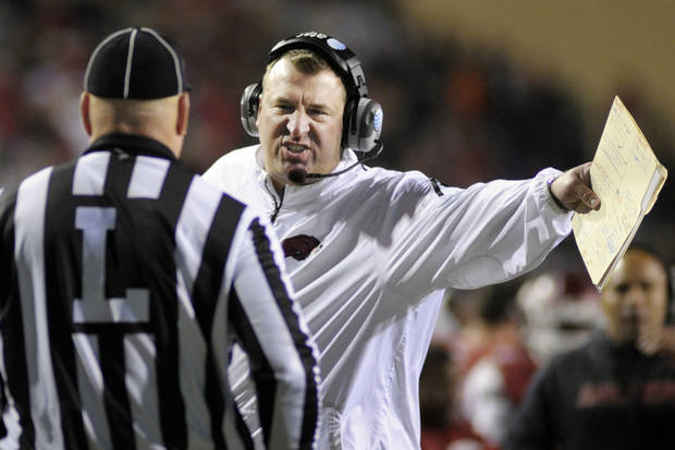 photo - Arkansas coach Bret Bielema talks to an official during the second half of an NCAA college football game against the Auburn, in Fayetteville, Ark., Saturday, Nov. 2, 2013. Auburn won 35-17. (AP Photo/Beth Hall)