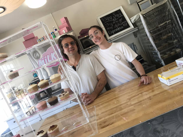 Eric and Quinn Smith inside the new Sara Sara Cupcakes.