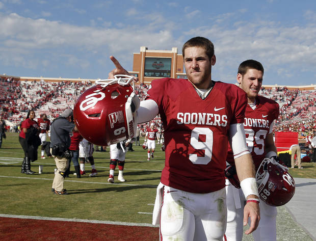 photo - Oklahoma's Trevor Knight (9) points to the fans after the 48-10 win over Iowa State during the college football game between the University of Oklahoma Sooners (OU) and the Iowa State University Cyclones (ISU) at Gaylord Family-Oklahoma Memorial Stadium in Norman, Okla. on Saturday, Nov. 16, 2013. Photo by Chris Landsberger, The Oklahoman