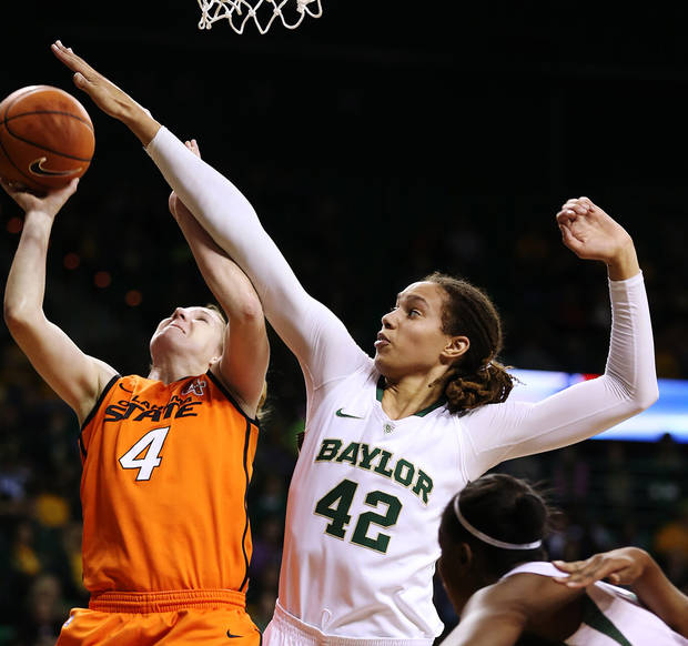 photo - Baylor's Brittney Griner (42) pressures Oklahoma State's Liz Donahoe (4) during the first half of their NCAA college basketball game, Sunday, Jan. 6, 2013, in Waco, Texas. (AP Photo/The Waco Tribune-Herald, Rod Aydelotte) ORG XMIT: TXWAC101