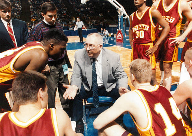 photo - Gerald Stockton, center, coaches Midwestern State. Photo by the Wichita Falls Times Record News