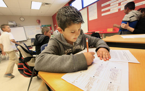 photo -      Third-grader Abimael Quinonez, 9, works on a reading exercise Wednesday during intersession at Herronville Elementary School in Oklahoma City. Photo by Paul B. Southerland, The Oklahoman   PAUL B. SOUTHERLAND -  PAUL B. SOUTHERLAND