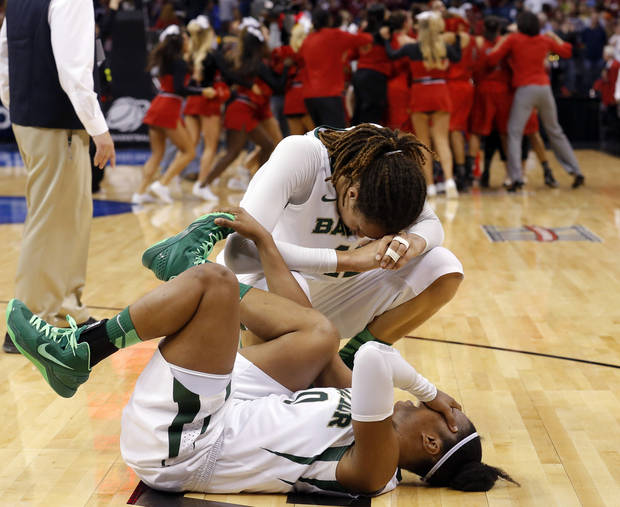 photo - Baylor's Brittney Griner (42) and Odyssey Sims (0) react following their loss to Louisville at the Oklahoma City Regional for the NCAA women's college basketball tournament at Chesapeake Energy Arena in Oklahoma City, Sunday, March 31, 2013. Photo by Sarah Phipps, The Oklahoman