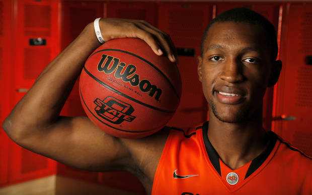 photo - OSU men's basketball player Kamari Murphy (21) poses for a photo during basketball media day for Oklahoma State University at Gallagher-Iba Arena in Stillwater, Okla., Monday, Oct. 22, 2012. Photo by Nate Billings, The Oklahoman