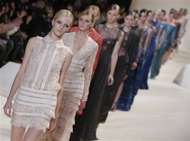 photo - Models wear creations by designer Elie Saab as part of his ready to wear Spring-Summer 2013 collection, in Paris, Wednesday, Oct. 3, 2012. (AP Photo/Francois Mori)