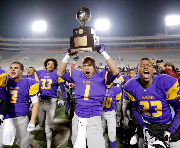 photo - CELEBRATE / CELEBRATION: Anadarko's Sheldon Wilson holds the championship trophy after winning the Class 3A high school football state championship game between Cascia Hall and Anadarko 35-18 at Boone Pickens Stadium in Stillwater, Friday, Dec. 9, 2011. Photo by Bryan Terry, The Oklahoman