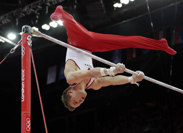 photo - U.S. gymnast Jonathan Horton performs on the horizontal bar during the artistic gymnastics men's apparatus finals at the 2012 Summer Olympics, Tuesday, Aug. 7, 2012, in London.  (AP Photo/Gregory Bull)