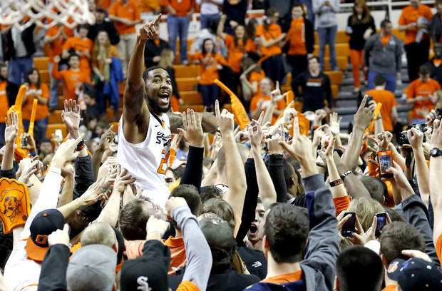 photo - OU / OSU / CELEBRATION: Oklahoma State's Michael Cobbins (20) celebrates with fans during the Bedlam men's college basketball game between the Oklahoma State University Cowboys and the University of Oklahoma Sooners at Gallagher-Iba Arena in Stillwater, Okla., Saturday, Feb. 16, 2013. Photo by Sarah Phipps, The Oklahoman