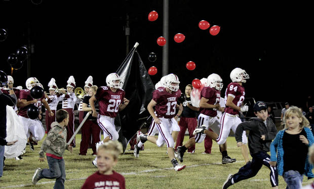 photo - The Tuttle Tigers and some fans run onto the field as they prepare to play the Weatherford Eagles in high school football on Friday, Oct. 21, 2011, in Tuttle, Okla.   Photo by Steve Sisney, The Oklahoman ORG XMIT: KOD