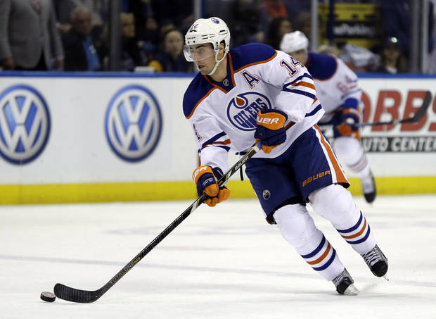 photo - Edmonton Oilers' Jordan Eberle handles the puck during the third period of an NHL hockey game against the St. Louis Blues Friday, March 1, 2013, in St. Louis. The Blues won 4-2. (AP Photo/Jeff Roberson) ORG XMIT: MOJR