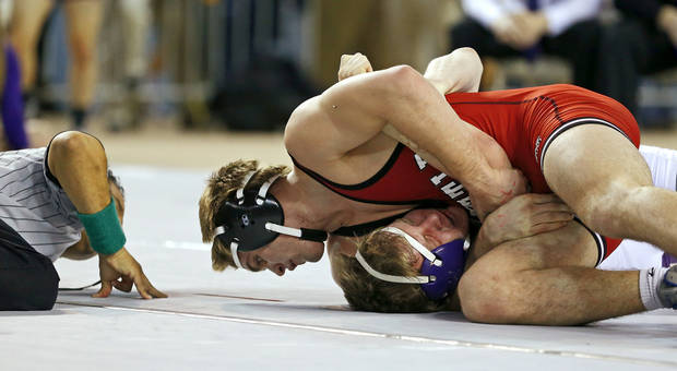 photo - Tuttle's Zach Beard, top, wrestles Mannford's Luke May in the Class 4A 170-pound championship match in the state wrestling championships at the State Fair Arena in Oklahoma City, Saturday, Feb. 23, 2013. Photo by Bryan Terry, The Oklahoman