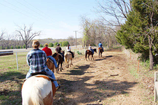 photo - Riders follow the trail at Sequoyah State Park near Wagoner. Trail rides are offered by Sequoyah Riding Stables.STATE TOURISM PHOTO