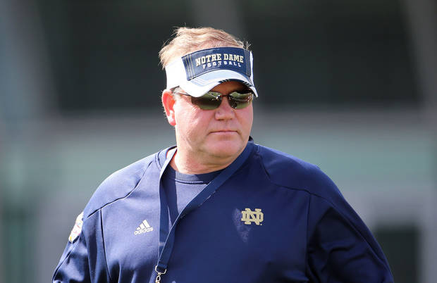 photo - Notre Dame Head Football Coach Brian Kelly during a training session at the Aviva Stadium, Dublin, Ireland, Thursday, Aug. 30, 2012.  American college football team Notre Dame play the Navy team on Saturday in Dublin.  (AP Photo/Peter Morrison) ORG XMIT: XPM107