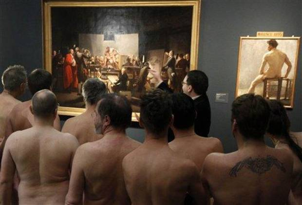 photo - RETRANSMISSION  OF XRZ102 In this Monday, Feb. 18, 2013 photo, Naked Museum visitors look at pictures of the show