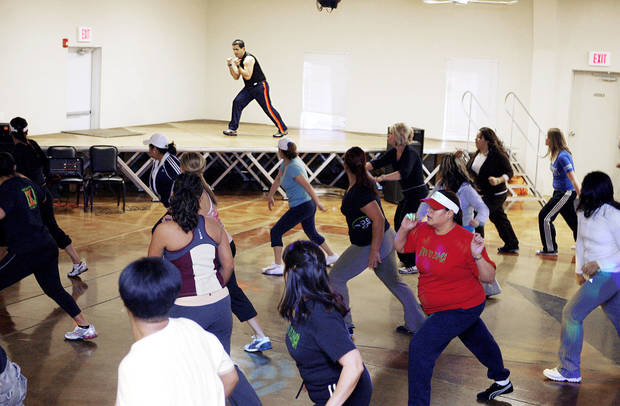 photo - Left: Instructor Jose Munoz leads a Zumba marathon at the Palacio del Sol in Oklahoma City. PHOTO BY PAUL HELLSTERN, THE OKLAHOMAN