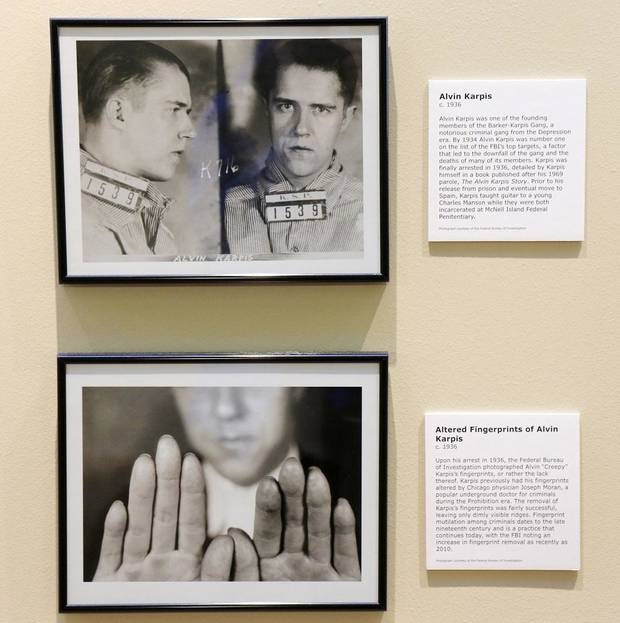"Photos depict Alvin Karpis, who altered his fingerprints to enable his gang activites, in the Oklahoma History Center's exhibit ""Wanted: Dead or Alive."" The photography exhibit is comprised of images of some of Oklahoma's most infamous outlaws and lesser-known criminals and will be on display until Feb. 29. [Photo by Doug Hoke/The Oklahoman]"