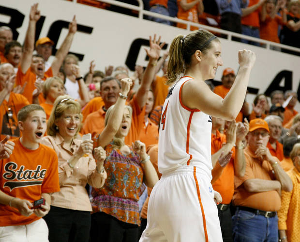 photo - WNIT / WOMEN'S COLLEGE BASKETBALL TOURNAMENT / CELEBRATION: Oklahoma State's Liz Donohoe (4) celebrates during the women's NIT semifinal college basketball game between Oklahoma State University (OSU) and San Diego at Gallagher-Iba Arena in Stillwater, Okla., Wednesday, March 28, 2012. Oklahoma State won 73-57. Photo by Bryan Terry, The Oklahoman