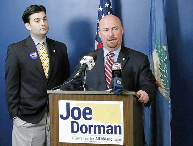 photo - Democratic gubernatorial candidate Joe Dorman speaks at his campaign headquarters with Rep. Eric Proctor (left) in Tulsa, Okla. on Thursday, July 10, 2014. MATT BARNARD/Tulsa World