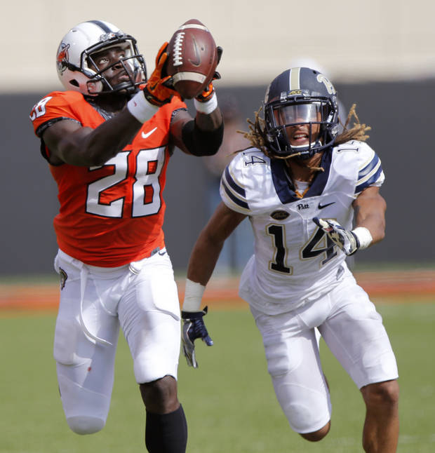Oklahoma State's James Washington (28) makes a touchdown catch in front of Pittsburgh's Avonte Maddox (14) during a college football game between the Oklahoma State Cowboys (OSU) and the Pitt Panthers at Boone Pickens Stadium in Stillwater, Okla., Saturday, Sept. 17, 2016. Photo by Chris Landsberger, The Oklahoman
