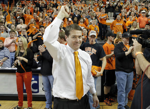 photo - CELEBRATION: Travis Ford celebrates the 69-67 overtime win against Baylor during the college basketball game between the Oklahoma State University Cowboys (OSU) and the Baylor University Bears (BU) at Gallagher-Iba Arena on Wednesday, Feb. 6, 2013, in Stillwater, Okla. Photo by Chris Landsberger, The Oklahoman